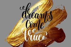 Dreams come true - hand lettering positive quote on golden brush Royalty Free Stock Images
