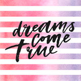 Dreams come true lettering on watercolor stripes in violet and pink colors. Stock Images