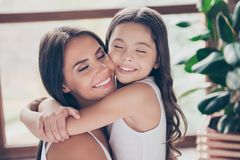 Dreams come true! My dear mummy is here and she`ll never leave m. E alone! Close up photo of cute tender mother and her preteen daughter, they are hugging and Royalty Free Stock Photos