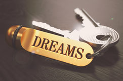 Dreams. Concept on Golden Keychain. Royalty Free Stock Photos