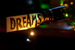 Dreams concept. The word dream, bottle and multicolored lights Royalty Free Stock Images