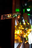 Dreams concept. The word dream, bottle and multicolored lights Stock Photography