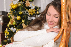 Dreams of cute girl in christmastime Royalty Free Stock Photos