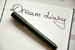 Dreams diary concept. Dream diary concept with a notebook and a pen to write the dreams royalty free stock photos