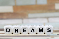 Dreams, dice letters Stock Photography