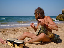 Dreams with drum on a sea. Man drum on tam-tam and looks on a sea Royalty Free Stock Photos