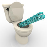 Dreams Flushing Down the Toilet. The word Dreams being flushed down a toilet Stock Photos
