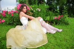 Dreams of future. Beautiful princess in white-golden gown dreams of future Royalty Free Stock Photo