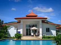 Dreams house with pool. Dreams house with swimming pool and blue sky Royalty Free Stock Photo