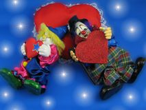 Dreams about love. Two loving clowns are sleeping on red heart Vector Illustration