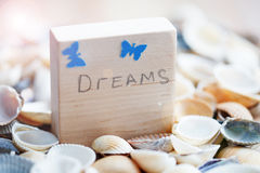 Dreams message on the beach - vacation and travel concept Royalty Free Stock Photography