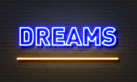 Dreams neon sign on brick wall background. Royalty Free Stock Photography