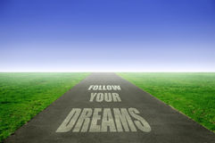 Dreams. Open road with follow your dreams text stock images