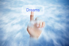 Dreams. Press a button with text Dreams stock photography