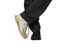 Dreams & reality :-). Man wearing suit and sport and elegant shoes Stock Photography