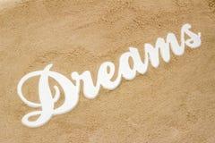 Dreams on the sandy beach. The sandy beach is the writing Dreams from wood Stock Photos