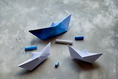 Dreams about the sea. A symbol of travel and freedom. A ship made of paper.Pastel crayons. Dreams about the sea. A symbol of travel and freedom. A ship made of stock image