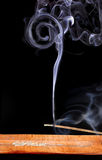 Dreams smoke of incense. A stick of incense being consumed. The smoke rises creating relaxing forms, Dreamstime this way Royalty Free Stock Images