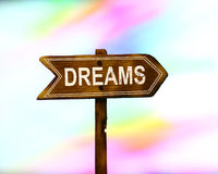 Dreams text white paint on colorful sweet bokeh background. Stock Photos