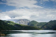 Dreams time. Komani Lake in Albania, an unspoiled spot of nature Royalty Free Stock Photos