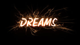 DREAMS title word in glowing sparkler Stock Photo