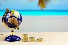 In dreams for travel. Globe and money for travel on the beach background stock images
