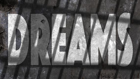 Dreams Written On A Wall. With Jail Bars Shadow Royalty Free Stock Photography