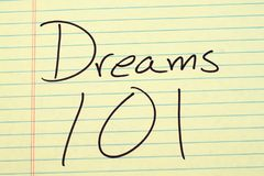 Dreams 101 On A Yellow Legal Pad. The words `Dreams 101` on a yellow legal pad Royalty Free Stock Images