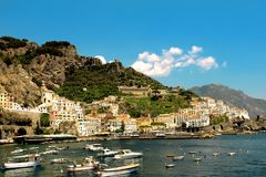 Italy Landscape - Colourful panoramic Landscape at Amalfi Village. Dreamstime collection - Amazing view at Amalfi Village - Mountains ,ocean, boats and a blue stock photos