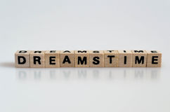 Dreamstime Concept. The word dreamstime written in cube letters on white background stock photo