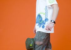 Dreamstime Shirt and Cap. Young male wearing dreamstime shirt and wearing shorts with dreamstime cap attached, orange background stock images