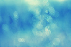 Dreamy abstract winter season blurred nature bokeh. Dreamy abstract winter season blurred nature background. Lovely blurry cyan blue colored bokeh background royalty free stock photo
