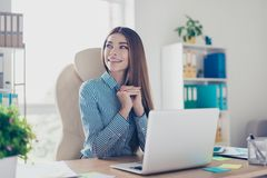 Dreamy attractive business lady is looking away and think of vac. Ation. She is in a smart striped shirt stock images