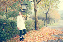 Dreamy Autumn. Young woman standing in a beautiful autumn scenery Royalty Free Stock Images