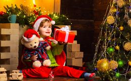 Dreamy baby toddler on christmas eve. Believe in christmas miracle. Wish to meet santa claus. Winter holidays. Merry. Christmas and happy new year. Happy stock photo