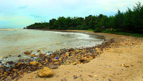 Jatisari Beach. Dreamy beach enjoying ocean colorful violet sky view. Landscape nature screen saver Royalty Free Stock Images