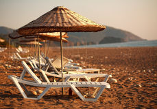 Dreamy beach with sun loungers under parasol Royalty Free Stock Photos