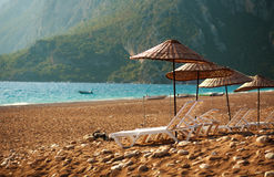 Dreamy beach with sun loungers under parasol Royalty Free Stock Images