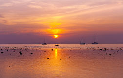 Dreamy beach sunset yachts Concept Royalty Free Stock Image