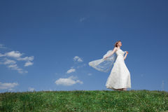 Dreamy beautiful blonde bride walking Royalty Free Stock Image