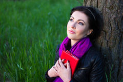 Dreamy beautiful woman with book in summer park Royalty Free Stock Images