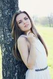 Dreamy beautiful woman near the tree Stock Image