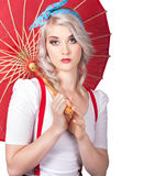 Dreamy blond pin up woman with parasol. Old style Stock Photography