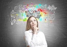 Dreamy blonde businesswoman, brainstorm Stock Photos