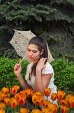 Dreamy brunette with an umbrella Stock Photos