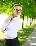 Dreamy business lady in white shirt and glasses Royalty Free Stock Photography