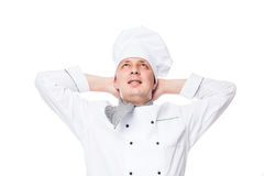 Dreamy chef in a cap. On a white background isolated Royalty Free Stock Image