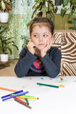 Dreamy child draws Royalty Free Stock Images