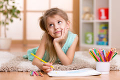 Dreamy child girl drawing with color pencils Royalty Free Stock Images