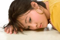 Dreamy Chinese woman. Lying On the floor Stock Image